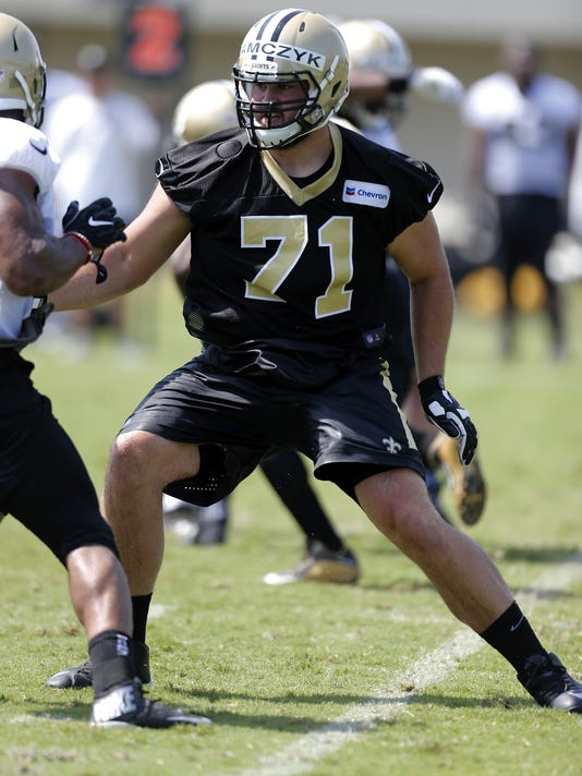 New Orleans Saints offensive tackle Ryan Ramczyk (71) runs a drill during an NFL football training camp in Metairie, La., Friday, July 28, 2017. (AP Photo/Jonathan Bachman)