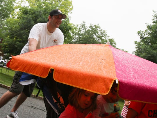 Attendees at the annual Miles for Matheny made the best of it as inclment weather cut short the day's activities.