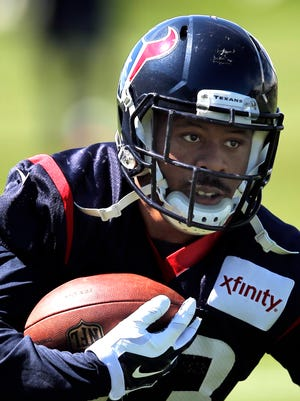 Houston Texans running back William Powell runs a drill Aug. 19, 2014, in Englewood, Colo.