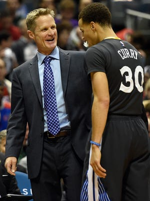 Golden State Warriors head coach Steve Kerr reacts with guard Stephen Curry (30) in the fourth quarter during the game against the Milwaukee Bucks at BMO Harris Bradley Center.