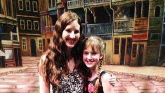 """Anna Kate Cibrian with director Laura Luc on the stage of """"A Little Princess."""""""