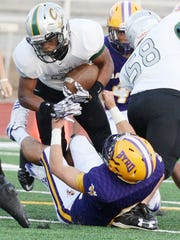 Calvary's Kordavion Washington tries to get past Byrd's