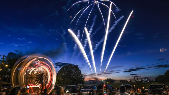 """Liberation Day fireworks drew """"oohs"""" and """"ahhs"""" at the Liberation Carnival grounds on Liberation Day 2015."""