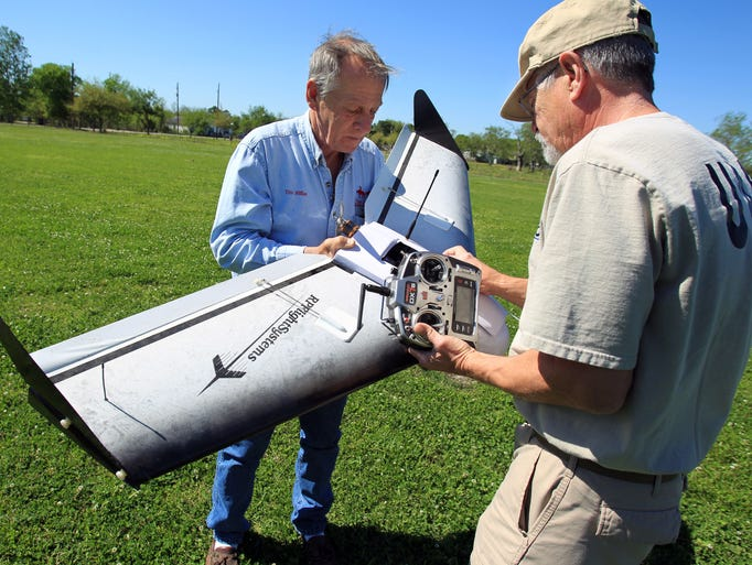 Tim Miller, founder of EquuSearch, and volunteer Gene Robinson, who builds the group's drones, checks out the drone they have used for searches in Santa Fe, Texas.