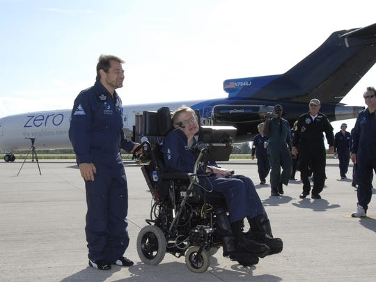 Peter Diamandis, left, founder of Zero Gravity Corp., and noted physicist Stephen Hawking move away from Zero-G's modified Boeing 727 on the runway at Kennedy Space Center Shuttle Landing Facility on April 26, 2007, after Hawking enjoyed his first zero-gravity flight.