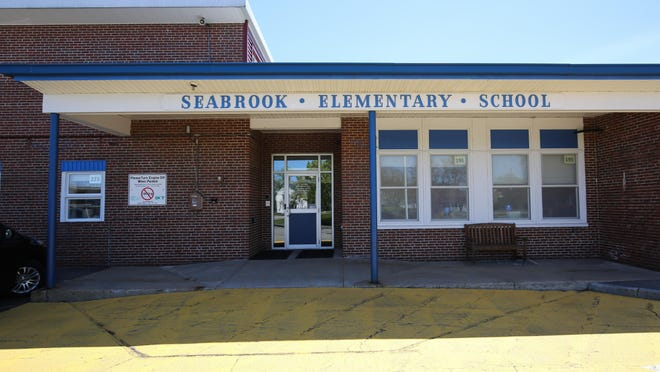 A Seabrook Elementary School student tested positive for COVID-19, requiring more than a dozen students and their families to self-quarantine this week.