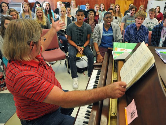 In this 2015 file photo, Gary Miller (left), choral director at Indian River Charter School, prepares students for a trip to Carnegie Hall in New York City.