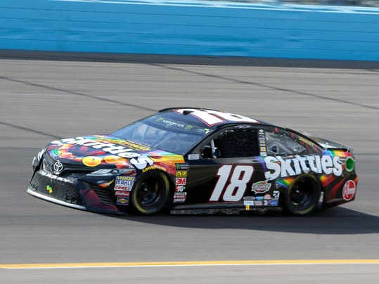 Monster Energy NASCAR Cup Series driver Kyle Busch (18) on lap 130 during a NASCAR Cup Series auto race on Sunday, March 11, 2018, in Avondale, Ariz. (AP Photo/Rick Scuteri)