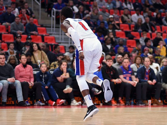Pistons guard Reggie Jackson (1) reacts after being