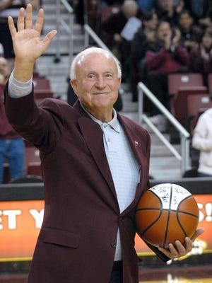 Robin Zielinski/Sun-News Lou Henson waves to the crowd as they honor him with a standing ovation during halftime at the Pan American Center for Saturday's Lou Henson Classic game.