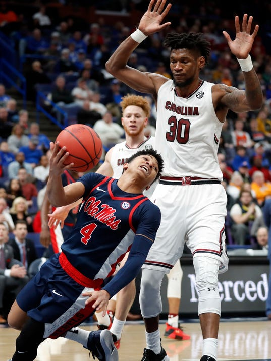 Mississippi 's Breein Tyree (4) passes the ball before falling out of bounds as South Carolina's Chris Silva (30) watches during the second half in an NCAA college basketball game at the Southeastern Conference tournament Wednesday, March 7, 2018, in St. Louis. (AP Photo/Jeff Roberson)