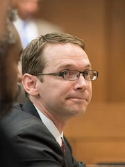 Texas Education Agency Commissioner Mike Morath testifies on school board issues before the Senate Committee on Education Aug. 16.