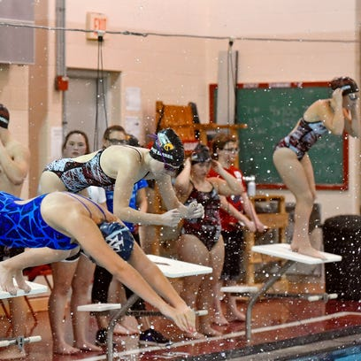 Dover's Sophie Barnes, middle, dives in as the second