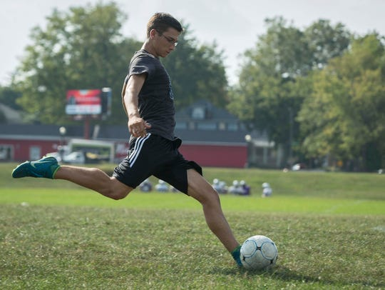 Central Soccer player Clark Bailey practices with his