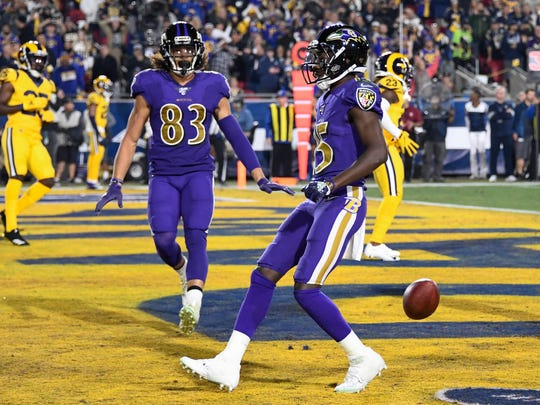 Nov 25, 2019; Los Angeles, CA, USA; Baltimore Ravens wide receiver Marquise Brown (15) scores a touchdown on a 6 yard pass from quarterback Lamar Jackson (not pictured) in the first quarter against the Los Angeles Rams at Los Angeles Memorial Coliseum. Mandatory Credit: Robert Hanashiro-USA TODAY Sports