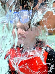 Children cool off at the water park at Killens Pond,