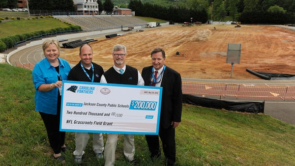 Smoky Mountain held a ceremonial groundbreaking for its artificial turf field Friday in Sylva.