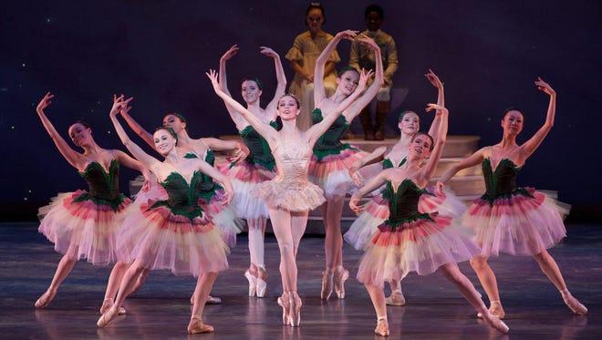 "Ballet Arizona dancers and Jillian Barrell (center) in a scene from the Ballet Arizona production of ""The Nutcracker."""