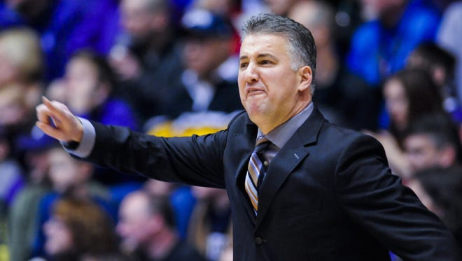 Purdue head coach Matt Painter yells against Northwestern during the first half of an NCAA college basketball game Saturday, Jan. 31, 2015, in Evanston, Ill.