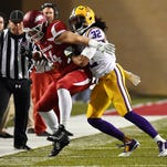 LSU cornerback Jalen Collins (32) knocks Arkansas tight end Hunter Henry (84) out of bounds at Donald W. Reynolds Razorback Stadium. Collins is expected to be a high draft pick.