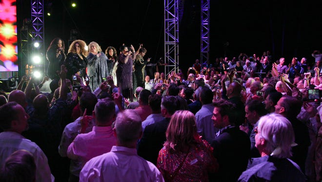 Grand finale by the Divas of Disco, during the 21st annual Evening Under the Stars fundraiser for the AIDS Assistance Program.