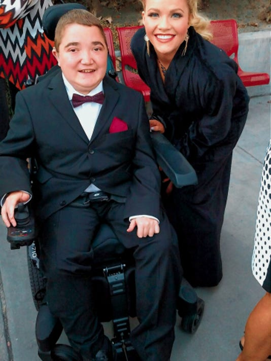 """""""Dancing with the Stars"""" contestant Witney Carson posed with El Pasoan Kyle Cox, who has Duchenne muscular dystrophy, when  he attended Monday night's taping of the ABC show."""