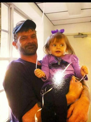 Lebanon police charged Joshua Eisenhour with aggravated assault in the death of Michael Reedy, pictured holding his niece in this undated photo, who died of injuries after being assaulted in front of the Willow House Tavern at North Fifth and Willow streets.