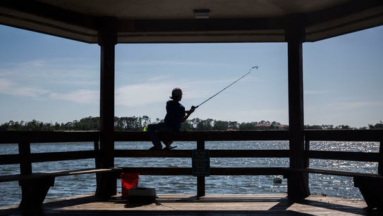 Joshua Segura, 11, casts out into the lake at Sugden