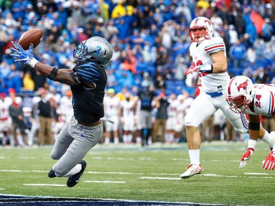Memphis receiver Anthony Miller (left) grabs a touchdown