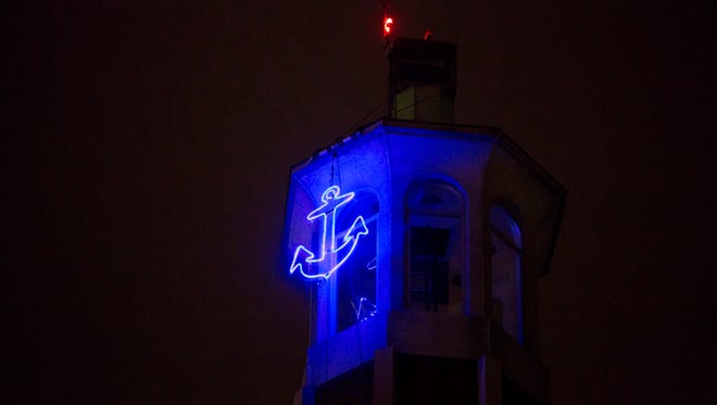 The new anchor is lit and hangs high on McMorran Tower Thursday, Dec. 31, in Port Huron.