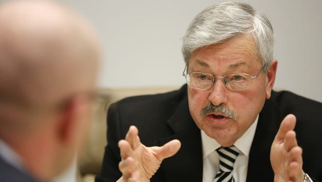 Gov. Terry Branstad answers a question from publisher David Chivers Wednesday, Jan. 13, 2016, following Branstad's meeting with The Des Moines Register editorial board in downtown Des Moines.