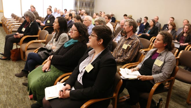 Hearing Room D is filled for a hearing on HB 4122, a bill to reverse 2013 legislation barring local communities from regulating GMO crops, Tuesday, Feb. 9, 2016, at the Oregon State Capitol in Salem, Ore. Twenty-six people signed up to testify.