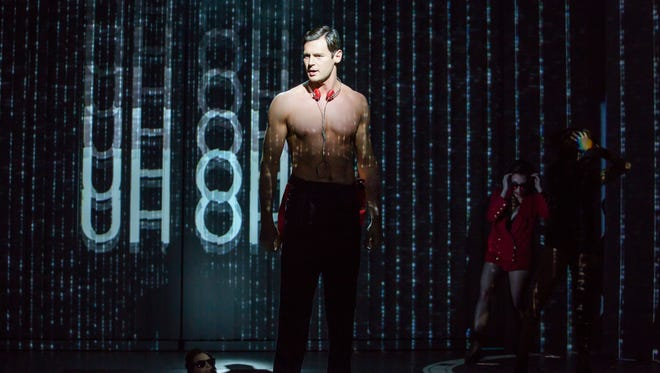 Benjamin Walker, playing the murderous investment banker Patrick Bateman, shows off his assets in the Broadway musical 'American Psycho.'