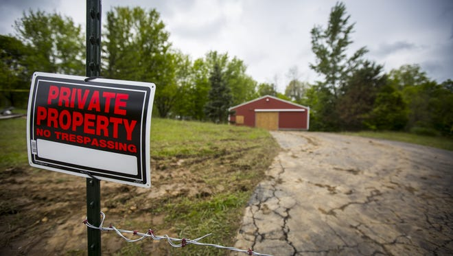 May 17, 2016: A garage is boarded up Tuesday on the property where Dana Rhoden and her two children, Hanna Rhoden and Chris Rhoden, Jr. were found shot and killed. Her mobile home and its additions were removed and seized by the Pike County Sheriff and the Ohio Bureau of Criminal Investigations.
