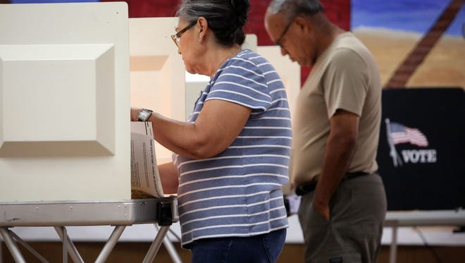 Voters fill out their ballots at St. Andrews Presbyterian Church in Indio on Tuesday, June 7, 2016 during the California Primary.