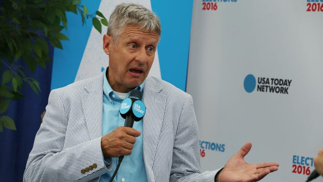 Libertarian presidential candidate Gary Johnson speaks with USA TODAY's Paul Singer during the 2016 Democratic National Convention in Philadelphia on July 28, 2016.