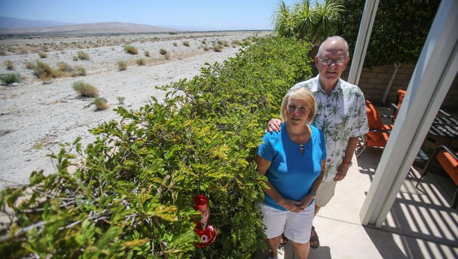 Jeri Barry and her husband Bill are concerned that they will loose their privacy if CV Link remains on top the levee behind their house. Photo taken on Friday, June 16, 2017, in the Palm Springs Four Seasons community.