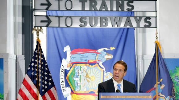 New York Gov. Andrew Cuomo addresses a gathering in the new concourse of Penn Station, the first phase of Moynihan Station, a long-delayed stairway concourse that will improve access for rail commuters at Penn Station in New York, Monday, June 19, 2017.