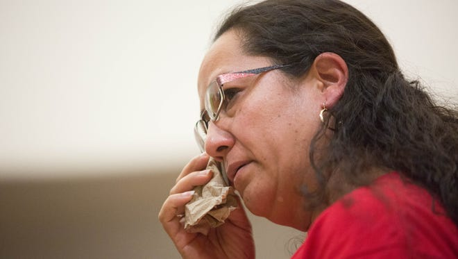 Martha Lorena Rivera, wipes tears from her eyes after speaking at a press conference held at Holy Cross Retreat Center, where she is seeking sanctuary from being deported. Monday November 6, 2017. Rivera has been working with her attorney to get granted a stay of removal and temporary relief so she can stay with her children.