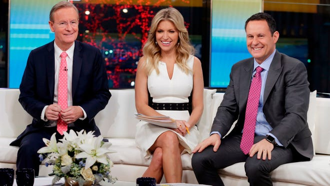 """""""Fox & Friends"""" co-hosts (from left) Steve Doocy, Ainsley Earhardt and Brian Kilmeade appear on their set in New York in January 2018."""
