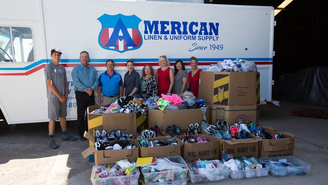Revolution 120 volunteers delivered on Monday, July 23, 2018, $11,000 worth of clothing from Walmart to help replenish the Gospel Rescue Mission Clothing Store inventory after a fire last month damaged much of its clothing. American Linen and Uniform Supply offered to clean what clothes could be salvaged.