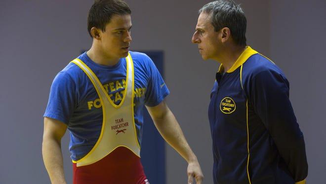 John du Pont (Steve Carell, right) offers instructions to Olympic wrestler Mark Schultz (Channing Tatum) in 'Foxcatcher.'