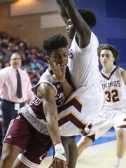 Caravel's Dwayne Earl (left) runs into St. Elizabeth's Jordan Brown in the first half of a DIAA state tournament semifinal at the Bob Carpenter Center Thursday.