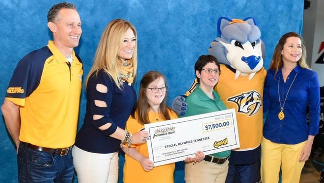 Nashville Predators Foundation board member Kristen Laviolette, second from left, presents a check to Special Olympics of Tennessee representatives, from left, Adam Germek, Emily Cage. Kara Jackson and Amy Parker