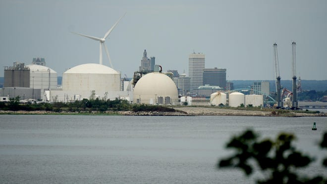 A view of the Fields Point storage tanks and Providence's skyline behind them as seen from across the Providence River in East Providence.