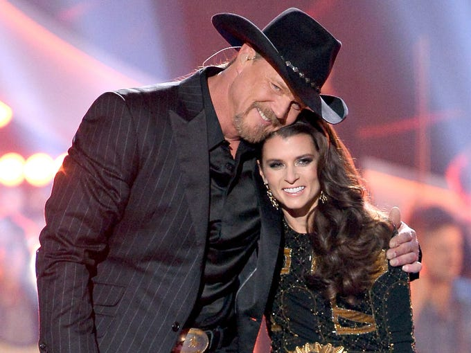LAS VEGAS, NV - DECEMBER 10:  Co-hosts Danica Patrick (R) and Trace Adkins speak onstage during the 2013 American Country Awards at the Mandalay Bay Events Center on December 10, 2013 in Las Vegas, Nevada.  (Photo by Ethan Miller/Getty Images)