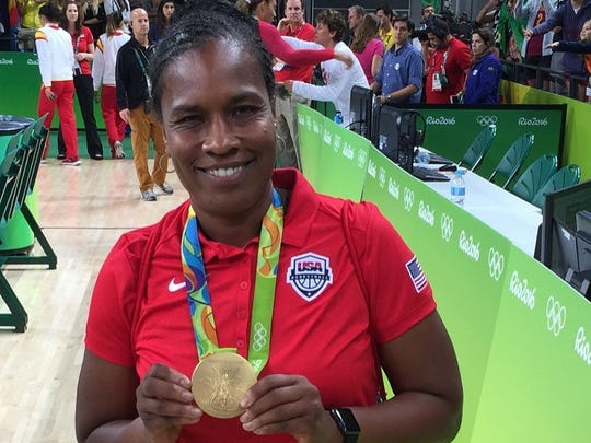 USA Basketball Coach Jamelle Elliott with a gold medal at the 2016 Olympic Games in Rio.