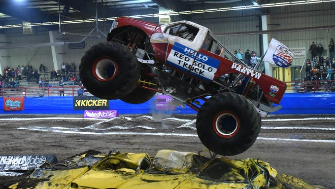 A driver competes in the Hole Shot Challenge on Friday during the Kicker Monster Truck Mania event at the McGee Park Coliseum.
