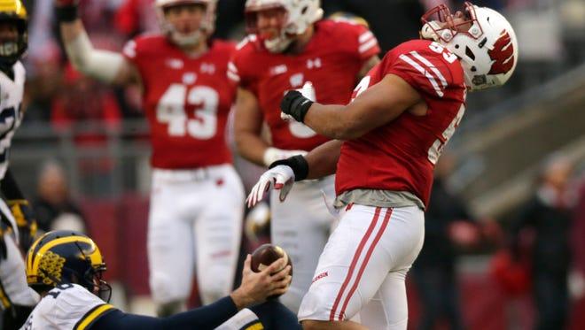 Wisconsin linebacker T.J. Edwards celebrates his sack of Michigan quarterback Brandon Peters last season.