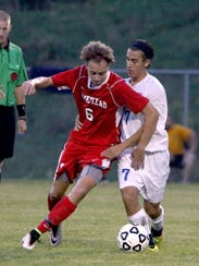 Homestead's Jack Sabinash (left)  battles Germantown's